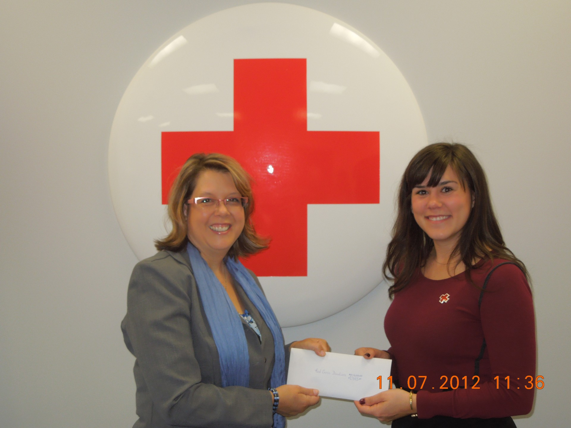 True Blue Realty Cookie Hooper Donates to Red Cross